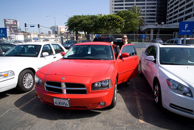 We had the option of a Prius or this V6 muscle car. No clearance, no 4WD, shit-house fuel economy and a boot. The red color sold us though...