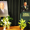 MSSU Athletics Director Jared Bruggeman speaks during Monday night's memorial for assistant football coach Derek Moore at MSSU's Corley Auditorium in Webster Hall.<br /> Globe | T. Rob Brown