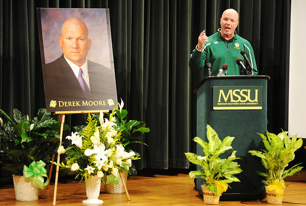 Head MSSU football coach Daryl Daye speaks during a memorial service in remembrance of Missouri Southern State University assistant football coach Derek Moore Monday evening, Nov. 4, 2013, at MSSU's Corley Auditorium in Webster Hall.<br /> Globe | T. Rob Brown