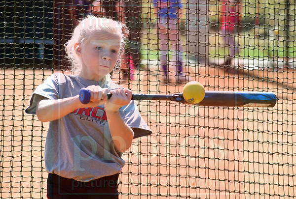 Matt Hamilton/Daily Citizen-News<br /> Kayden Stuckey, 10, practices her batting by hitting rubber balls full of sand on Friday during a softball camp at Coahulla Creek High School.