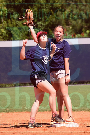 Matt Hamilton/Daily Citizen-News<br /> Amaris Bartley, 15, reacts after her teammate Steahl Smith, 15, tagged her out during a softball camp scrimmage on Friday at Coahulla Creek. While scrimmaging with the younger campers, the Lady Colts bat and field with their non-dominant hands to even the playing field.