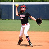 Matt Hamilton/Daily Citizen-News<br /> Annie Reed, 11, makes a throw to first during a softball camp at Coahulla Creek High School on Friday.