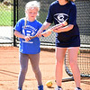 Matt Hamilton/Daily Citizen-News<br /> Coahulla Creek High School softball player Chloe Andis, 16, helps Bergen Bennett, 7, lean how to bunt on Friday at the school's softball camp.