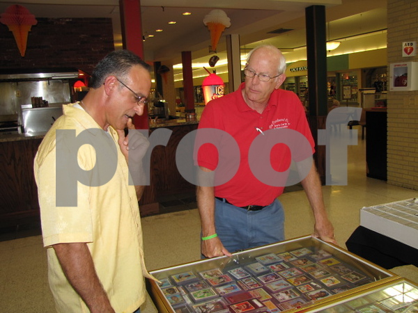 Joe Orosco talked with David Jensen about Jensen's sports cards at the Crossroads Mall in Fort Dodge.