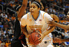 Dec 16, 2009; Knoxville, TN, USA; Tennessee Lady forward Alyssia Brewer (33) plants for a shot against Vols Louisville Cardinals forward Monique Reed (33) during the first half at Thompson Boling Arena. Mandatory Credit: Don McPeak-US PRESSWIRE