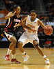 Dec 16, 2009; Knoxville, TN, USA; Tennessee Lady Vols guard Kamiko Williams (4) drives on Louisville Cardinals guard Rachel Story (30) during the second half at Thompson Boling Arena. The Lady Vols beat the Cardinals 86-56. Mandatory Credit: Don McPeak-US PRESSWIRE