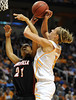 Dec 16, 2009; Knoxville, TN, USA; Tennessee Lady Vols forward Angie Bjorklund (5) is fouled by Louisville Cardinals  guard Ashley Rainey (21) during the first half at Thompson Boling Arena. Mandatory Credit: Don McPeak-US PRESSWIRE
