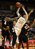 Dec 16, 2009; Knoxville, TN, USA; Tennessee Lady Vols forward Glory Johnson (25) is fouled by Louisville Cardinals guard Gwen Rucker (4) during the second half at Thompson Boling Arena. The Lady Vols beat the Cardinals 86-56. Mandatory Credit: Don McPeak-US PRESSWIRE