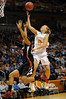 Dec 16, 2009; Knoxville, TN, USA; Tennessee Lady Vols forward Angie Bjorklund (5) shoots against Louisville Cardinals forward Monique Reid (33) during the first half at Thompson Boling Arena. The Lady Vols beat the Cardinals 86-56. Mandatory Credit: Don McPeak-US PRESSWIRE