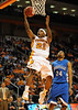 Nov 17, 2009; Knoxville, TN, USA; Tennessee Volunteers guard Melvin Goins (21) drives on UNC Asheville Bulldogs forward Terrence Turner (24) during the second half at Thompson-Boling Arena. The Volunteers beat the Bulldogs 124-49. Mandatory Credit: Don McPeak-US PRESSWIRE