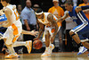 Nov 17, 2009; Knoxville, TN, USA; Tennessee Volunteers guard Melvin Goins (21) steals the ball from UNC Asheville Bulldogs guard J P Primm during the first half at Thompson-Boling Arena. Mandatory Credit: Don McPeak-US PRESSWIRE