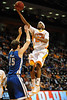 Nov 17, 2009; Knoxville, TN, USA; Tennessee Volunteers forward Cameron Tatum (23) drives to the basket against UNC Asheville Bulldogs guard Sean Smith (15) during the second half at Thompson-Boling Arena. The Volunteers beat the Bulldogs 124-49. Mandatory Credit: Don McPeak-US PRESSWIRE