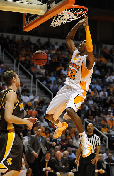 Dec 15, 2009; Knoxville, TN, USA; Tennessee Volunteers guard Scotty Hopson (32) jams over Wyoming Cowboys forward Rob Watsabaugh (32) during the second half at Thompson Boling Arena. The Volunteers beat the Cowboys 77-58. Mandatory Credit: Don McPeak-US PRESSWIRE