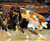 Dec 15, 2009; Knoxville, TN, USA; Tennessee Volunteers guard Scotty Hopson (32) drives past Wyoming Cowboys forward Afam Muojeke (11) during the second half at Thompson Boling Arena. The Volunteers beat the Cowboys 77-58. Mandatory Credit: Don McPeak-US PRESSWIRE