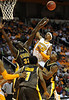Dec 15, 2009; Knoxville, TN, USA; Tennessee Volunteers guard Scotty Hopson (32) puts up a shot over Wyoming Cowboys center Boubacar Sylla (33) during the second half at Thompson Boling Arena. The Volunteers beat the Cowboys 77-58. Mandatory Credit: Don McPeak-US PRESSWIRE