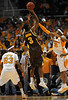 Dec 15, 2009; Knoxville, TN, USA; Tennessee Volunteers guard Bobby Maze (3) defends Wyoming Cowboys guard Desmar Jackson (3) during the first half at Thompson Boling Arena. Mandatory Credit: Don McPeak-US PRESSWIRE