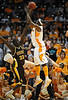 Dec 15, 2009; Knoxville, TN, USA; Tennessee Volunteers center Wayne Chism (4) shoots over Wyoming Cowboys center Boubacar Sylla (33) during the second half at Thompson Boling Arena. The Volunteers beat the Cowboys 77-58. Mandatory Credit: Don McPeak-US PRESSWIRE