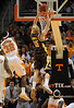 Dec 15, 2009; Knoxville, TN, USA; Wyoming Cowboys center Adam Waddell (15) scores against Tennessee Volunteers guard Scotty Hopson (32) during the first half at Thompson Boling Arena. Mandatory Credit: Don McPeak-US PRESSWIRE