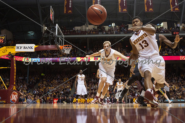 Minnesota Gophers guard Maverick Ahanmisi (13) and Minnesota Gophers center Elliott Eliason (55) chase a loose ball during the first half of the game.  On February 3, 2013 at the Minnesota Gophers game versus Iowa Hawkeyes at Williams Arena in Minneapolis, MN.