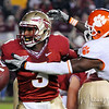 E.J. Manuel (3) looks to pitch the ball back to his player on an option play at the FSU vs. Clemson Football Game held on Nov 13.