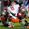 Strong defense by Kendall Smith (29) and Mister Alexander (16) keep a Clemson running back from gaining yardage at the FSU vs. Clemson Football Game held on Nov 13.