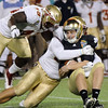 The Seminole defense makes a big sack during the Champs Sports Bowl on Dec. 29th.