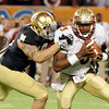 EJ Manuel (3) attempts to avoid a sack during the Champs Sports Bowl on Dec. 29th.