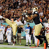 Greg Reid (5) goes up for the ball against a Notre Dame receiver during the Champs Sports Bowl on Dec. 29th.