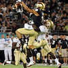 Mike Harris (1) puts tough defense on a Notre Dame receiver during the Champs Sports Bowl on Dec. 29th.