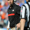Jan 2, 2012; Tallahassee, FL, USA; Ohio State Buckeyes head coach Luke Fickell tries to call a timeout during the first half of the 2012 Gator Bowl against the Florida Gators at EverBank Field.  Mandatory Credit: Melina Vastola-US PRESSWIRE