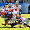 Jan 2, 2012; Tallahassee, FL, USA; Florida Gators wide receiver Frankie Hammond (85) is tackled by a group of Ohio State Buckeyes players during the first quarter of the 2012 Gator Bowl at EverBank Field.  Mandatory Credit: Melina Vastola-US PRESSWIRE