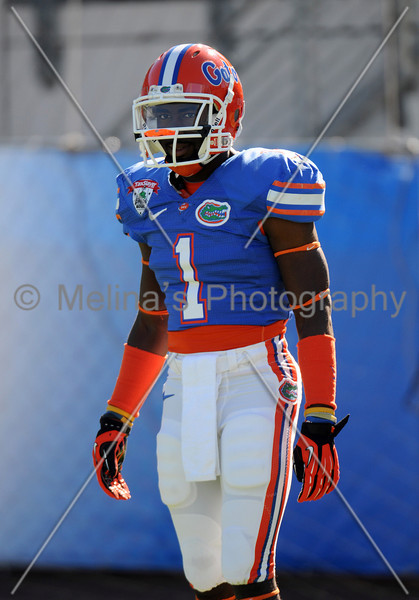 Jan 2, 2012; Jacksonville, FL, USA; Florida Gators running back Chris Rainey (1) warms up before the start of the 2012 Gator Bowl at EverBank Field.  Mandatory Credit: Melina Vastola-US PRESSWIRE