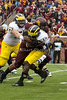On November 3,  Minnesota Gophers Ra'Shede Hageman defensive end (#99) sacks Michigan Wolverines Devin Gardner quarterback (12) for a loss at the Minnesota Gophers game versus Michigan Wolverines at TCF Bank Stadium in Minneapolis, MN.