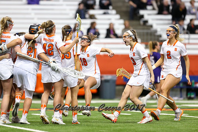 February 27, 2017; Syracuse, NY; USA; The No.4 Syracuse Orange celebrate their victory over the of the Albany Great Danes after a NCAA Division I women's lacrosse game at the Carrier Dome. Orange won 13-12.  Photo: Christopher Cecere/Inside Lacrosse
