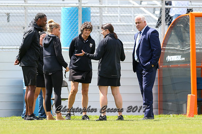 Head Coach Acacia Walker, Head Coach Gary Gait, and referees