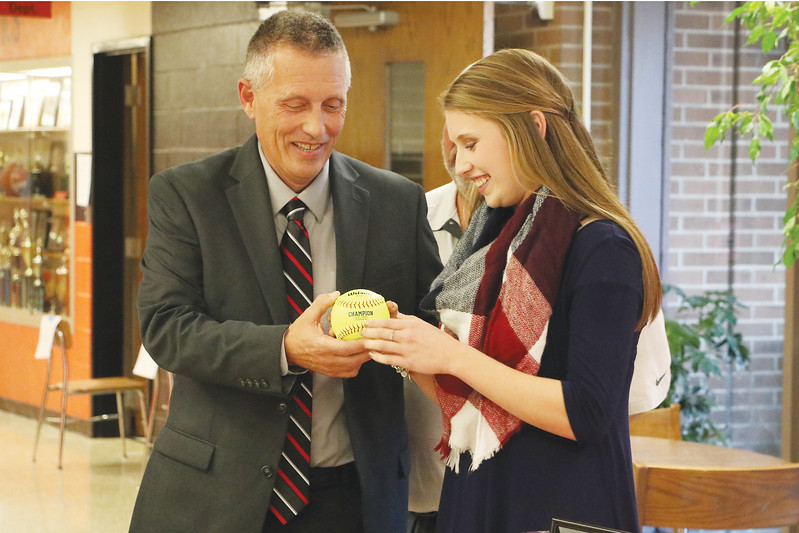 Star Photo/Bryce Phillips <br /> Elizabethton softball head coach Ken Hardin presents EHS senior Lauren Brickey with a ball signed by her teammates.