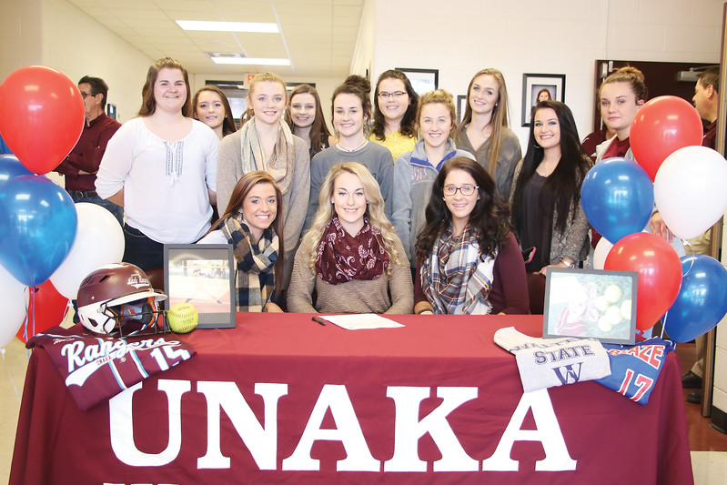 Star Photo/Bryce Phillips <br /> Unaka's Corie Schuettler is pictured with members of the Lady Rangers softball team.