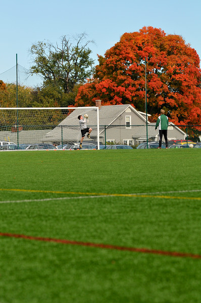 DSC_2009-13950. Newbury Keeper, Will McNally warms up with assistant coach Andrew LaFrenz.