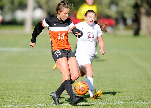 Don Knight | The Herald Bulletin Anderson University's Katie Frazer takes a shot as she is pursued by Earlham College's Emma Jones on Wednesday.