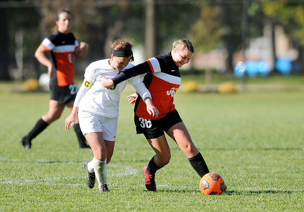 Don Knight | The Herald Bulletin Anderson University's Hannah Planck and Earlham College's Abby McCullough fight for control of the ball on Wednesday.