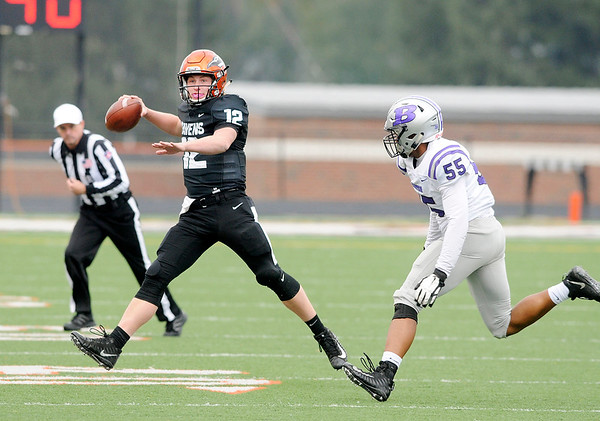Don Knight | The Herald Bulletin<br /> Anderson University quarterback Jarrod Hubble throws on the run as the Ravens hosted Bluffton on Saturday.