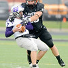 Don Knight | The Herald Bulletin<br /> Anderson University's Caleb Wooldridge sacks Bluffton quarterback Zachary Nobis on Saturday.
