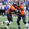 Don Knight | The Herald Bulletin<br /> Anderson quarterback Triston Anderson hands off to Demond Roberson-Miller as scores a touchdown in the first half as the Ravens hosted Bluffton for homecoming on Saturday.