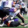 Don Knight | The Herald Bulletin<br /> Anderson's Caleb Wooldridge sacks Bluffton quarterback Conner Sheehan during homecoming on Saturday.