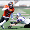 Don Knight | The Herald Bulletin<br /> Anderson's Travis Williams evades Bluffton's Brad Topp during homecoming on Saturday.