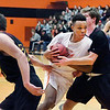 AU's Malik Laffoon gets grabbed by two Calvin defenders as he drives between them. The refs called a foul on the play.
