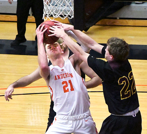 AU's Jake Gudorf fights for control of the ball after the ball is blocked by a Calvin defender as Gudorf drives the baseline to shoot.