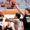 Don Knight | The Herald Bulletin<br /> Anderson University's Stanley Duncan scores while drawing a foul from Mount St. Joseph's  Bobby Murdock on Wednesday.