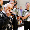 Don Knight | The Herald Bulletin<br /> Carl Erskine plays the national anthem on his harmonica before tip off as Anderson University hosted Franklin College on Saturday.