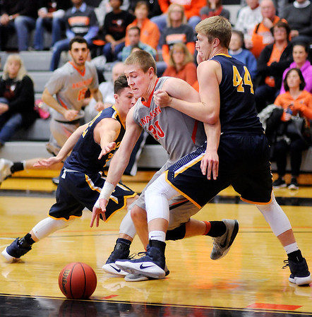 Don Knight | The Herald Bulletin<br /> Anderson University's Cole Hartman splits a pair of Franklin College defenders on a drive into the lane on Saturday.